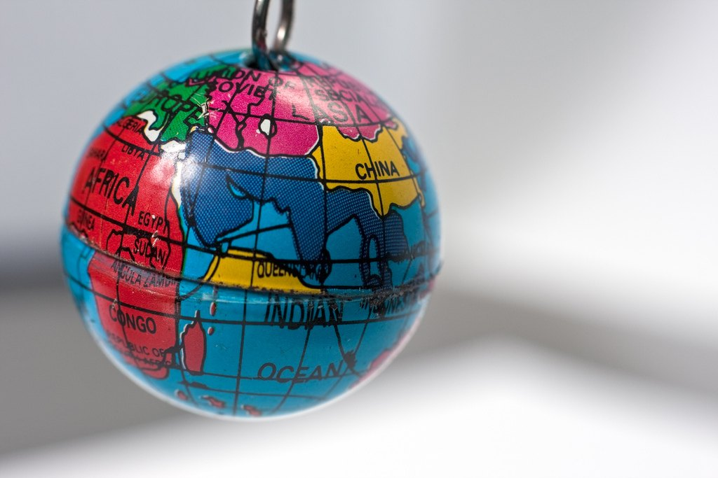 Old keychain in the shape of the world - CoderZ Blog