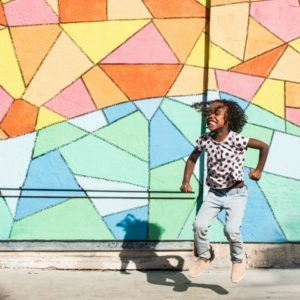 Young black female child excited to learn about stem