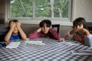young children bored at a table in need of stem activities