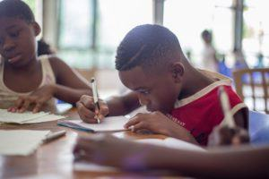 black male child reading homework problem-solving